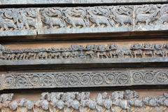 Hoysaleswara Temple outer wall carving depicting tug of war and mystical animals Stock Photography