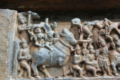 Hoysaleswara Temple outside temple carved with sculpture of Ishana lord of Northeast direction marching on his bull Royalty Free Stock Photography
