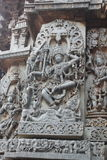 Hoysaleswara Temple outside wall carved with sculpture of lord shiva dancing on top of a demon. This is a Temple outside wall carved with sculpture of lord shiva Stock Images