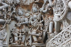 Hoysaleswara Temple Wall carved with Sculpture of Female dancer and male musician. This is a Temple Wall carved with Sculpture of Female dancer and male musician Stock Image