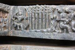 Hoysaleswara Temple wall carving of lord rama human killing Vaali monkey king while he was fighting with his brother sugreeva Royalty Free Stock Photos