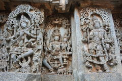 Hoysaleswara temple wall carving of Lord shiva and his wife Parvati Stock Photos