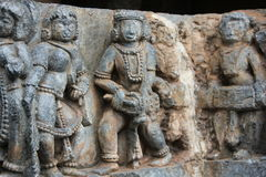 Hoysaleswara Temple wall carving of a male musician and female dancer performing Royalty Free Stock Image