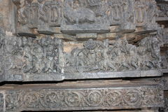 Hoysaleswara Temple wall carving row of carving depicting war scene Royalty Free Stock Image