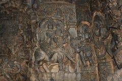 Hoysaleswara Temple wall carving of Uma Maheswara lord shiva and parvati. This is a wall carving of Uma Maheswara lord shiva and parvati. This carving is in Royalty Free Stock Image