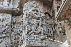 Hoysaleswara Temple wall carving of varaha avatar lord vishnu killing demon and saving mother earth. This is a wall carving of varaha avatar lord vishnu killing stock images