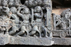 Hoysaleswara Temple Wall carving of warrior using a telescope Stock Images