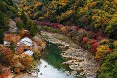 Hozu River in autumn, Arashiyama, Japan. Hozu River in autumn with fall foliage colors from Arashiyama top view, Kyoto, Japan Royalty Free Stock Photo