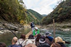 Hozugawa River Cruises at Arashiyama, Kyoto, Japan. Kyoto, Japan - December 2, 2015: Hozugawa River Cruises are sightseeing boat rides down the Hozugawa River Royalty Free Stock Photography