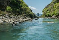 Hozugawa River by the rocky green hills. Hozugawa River along the rocky green hills. Arashiyama, Kyoto. Japan Royalty Free Stock Photos