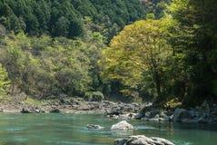 Hozugawa River by the rocky green hills. Hozugawa River along the rocky green hills. Arashiyama, Kyoto. Japan Stock Photography