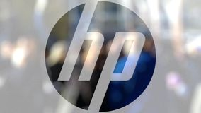 HP Inc. logo on a glass against blurred crowd on the steet. Editorial 3D rendering. HP Inc. logo on a glass against blurred crowd on the steet. Editorial 3D stock video footage