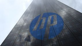 HP Inc. logo on a skyscraper facade reflecting clouds, time lapse. Editorial 3D rendering. HP Inc. logo on a skyscraper facade reflecting clouds, time lapse stock video footage