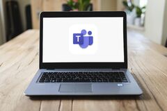 Free HP Laptop On Table With Microsoft Teams On Screen Stock Images - 183777234