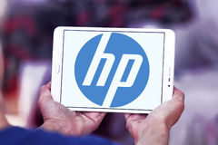 Hp logo. Logo of electronics company hp on samsung tablet in hands Royalty Free Stock Photo