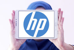 Hp logo. Logo of electronics company hp on samsung tablet holded by arab muslim woman Stock Photos