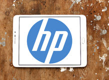 Hp logo. Logo of electronics company hp on samsung tablet on wooden background royalty free stock photo