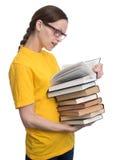Häpen kvinna i exponeringsglas som rymmer böcker Fotografering för Bildbyråer