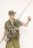 Häpen tonåring som fiskar den lilla fisken Arkivfoton