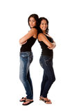 Hppy young girls back to back royalty free stock photo
