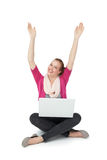 Hppy young woman with laptop raising hands Royalty Free Stock Photography