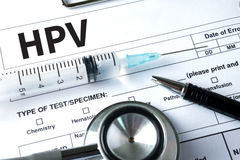 HPV CONCEPT    Virus vaccine with syringe  HPV criteria for pap. Smear slide cytology Stock Image