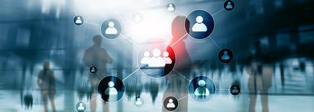 HR - Концепция управления человеческих ресурсов на запачканной предпосылке делового центра стоковое фото