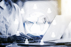HR concept. Side view of man using laptop with abstract hr icons around globe. Human resources concept. Filtered image royalty free stock photo