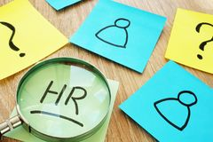 HR human resource written on a stick and magnifier. HR human resource written on a memo stick and magnifier stock photography