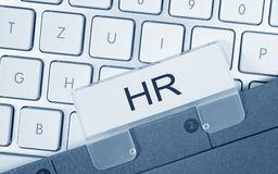 HR - Human Resources - folder with text on computer keyboard. In the office stock photography
