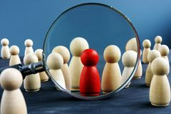 HR human resources and Recruitment. Wooden figures and magnifying glass