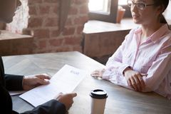 HR manager asks questions about resume to female applicant. stock images