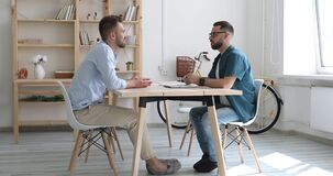 Hr manager handshaking hiring male applicant at meeting job interview