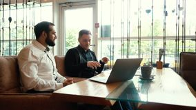 HR manager having job interview with young man in cafe stock footage