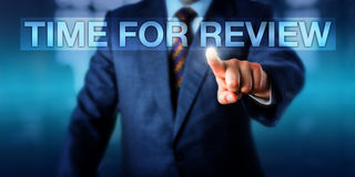 HR Manager Pressing TIME FOR REVIEW Royalty Free Stock Image