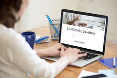 HR manager searching for new candidates online, human resource m. HR manager searching for new candidates online to fill open vacancy, recruiter working on Stock Photography