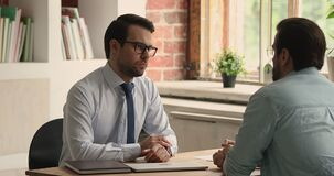 HR manager shake hands hired applicant accomplishing successfully job interview