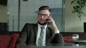 Hr-manager talking by phone in office. Conducts business negotiations. personnel selection. 4k uhd stock video