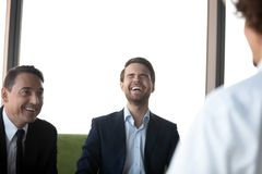 Job applicant make good first impression on laughing employers royalty free stock image