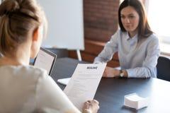 HR mangers hiring millennial female job candidate stock photos