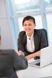 Hr meeting. Young office worker greeting a potential candidate for vacant position or a new partner Stock Photography