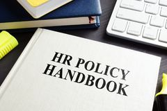 HR policy handbook on a desk. royalty free stock image