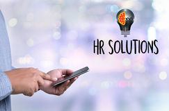 HR SOLUTIONS , choosing the perfect candidate to work , searchin. G for professional  HR SOLUTIONS , HR SOLUTIONS Business team hands at work with financial Royalty Free Stock Image