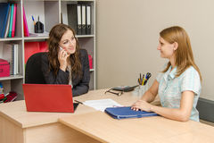 HR specialist negotiates a new employee on the phone Stock Images