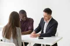 HR team considering candidate cv during recruitment process. Multiracial male hr agents reading female candidate resume, thinking about women candidature for stock photos