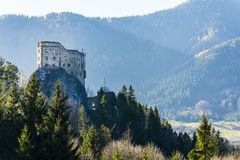 Hrad Likava castle located on the rock. View of the destroyed walls towering above the forest. Likavka, Slovakia - November 17, 2018: Hrad Likava castle located stock photos