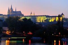 Hradcany Castle at dusk. View to Hradcany castle from across the moldavia at sunset Stock Photography