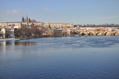 Hradcany and Prague Castle panorama - behind Vltav. This is famous panorama from Prague - Hradcany and Prague Castle in winter, under snow Stock Photos