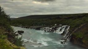 Hraunfossar瀑布在一阴天 库存图片