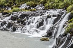 Hraunfossar Falls Iceland. All the water comes from the side of a lava field Stock Image
